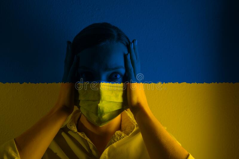 Girl in a mask against the background of the Ukraine flag,, danger and threat, outbreak of a dangerous virus. Photo. For articles, news stock images