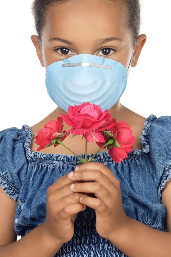 Girl with mask and flower royalty free stock photography