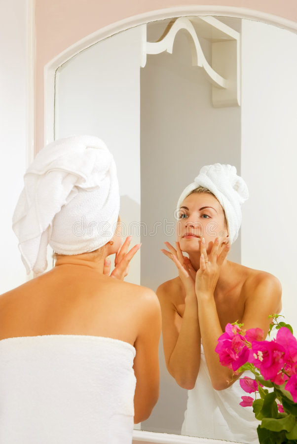 Girl massages her face stock photos