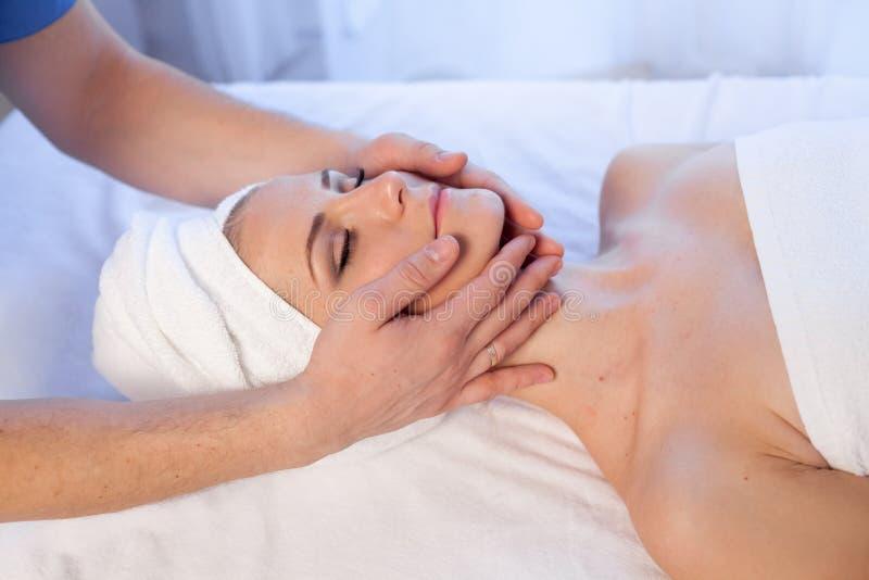Girl masseur doing massage neck face spa health. 1 stock photography