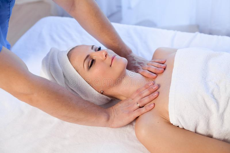Girl masseur doing massage neck face spa health. 1 royalty free stock photo