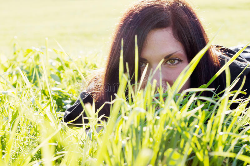 Girl in meadow stock photography