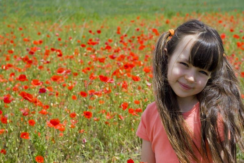 Girl on meadow royalty free stock photos