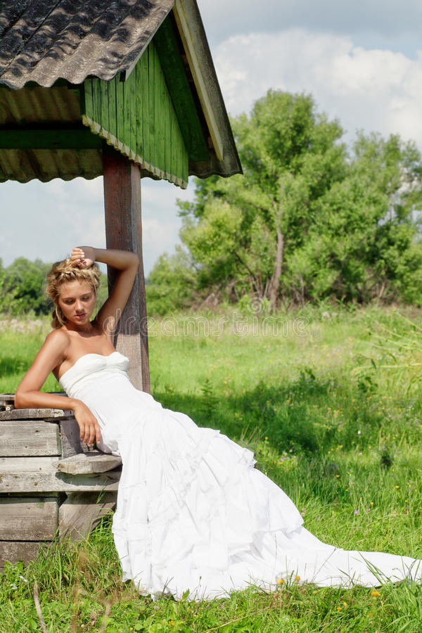 Girl on the meadow in summer day royalty free stock photography