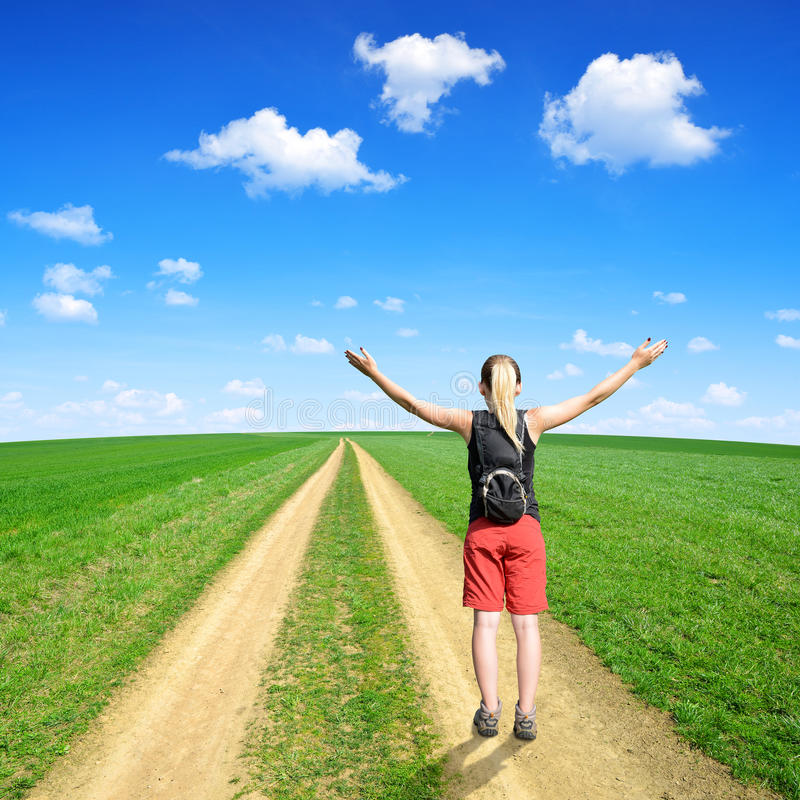 Girl on a meadow trail royalty free stock images