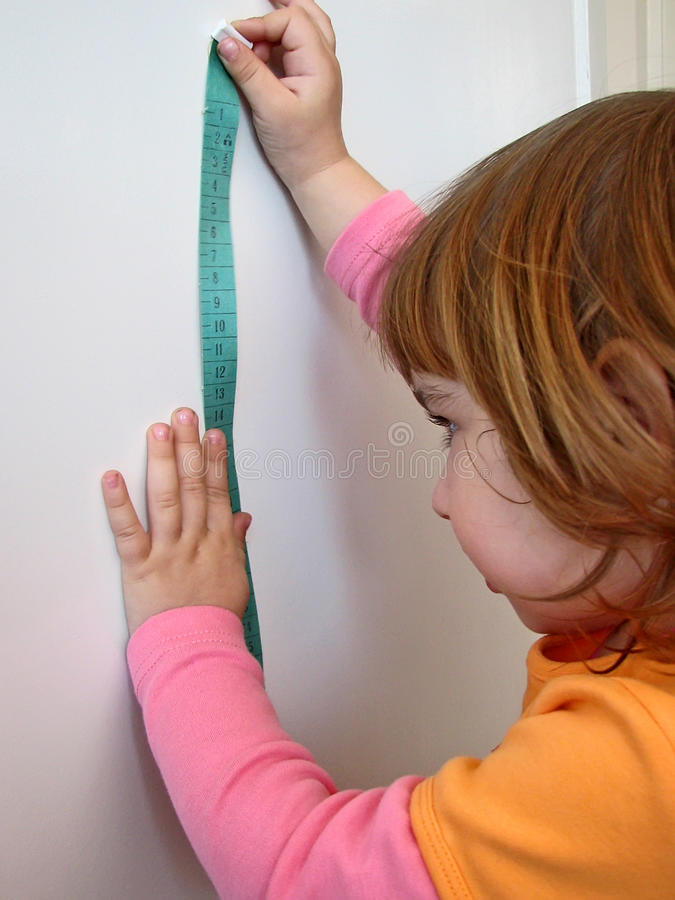 Girl measure royalty free stock photo