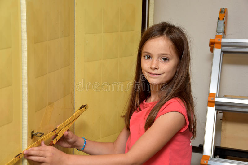 Girl with measure ruler stock image