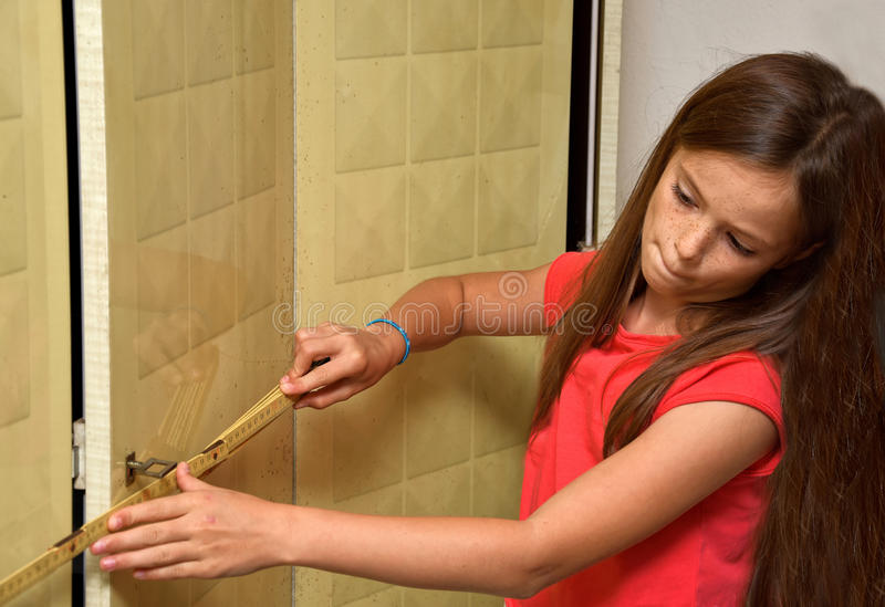 Girl with measure ruler stock photography