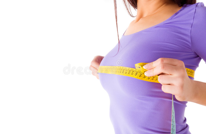 Girl Measures Her Breast Royalty Free Stock Photo
