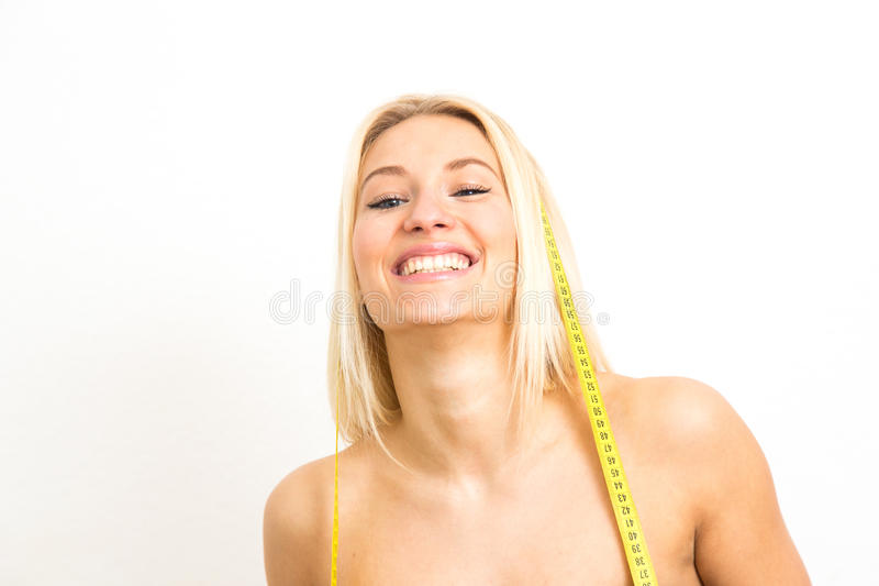 Girl measures her hips. royalty free stock photography