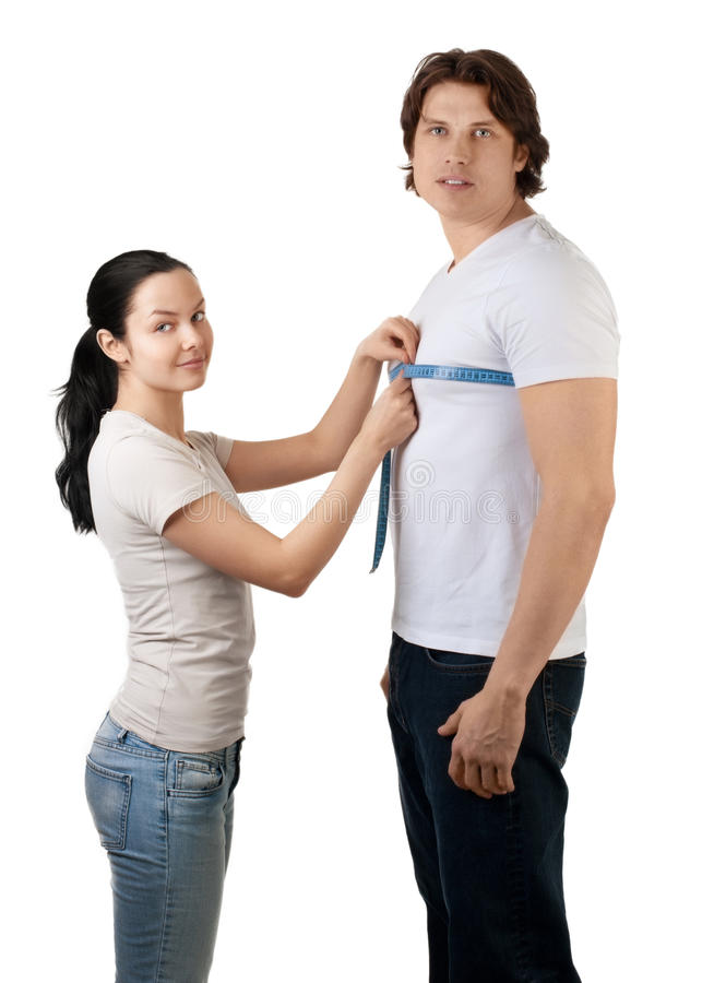 Download Girl Measuring The Chest Of Handsome Muscular Man Stock Images - Image: 17874194