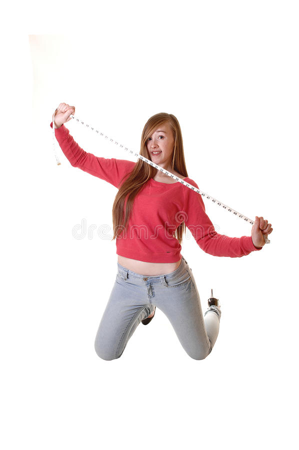 Girl with measuring tape. royalty free stock image
