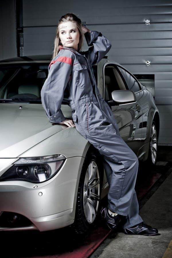 Girl in mechanic uniform stock photo