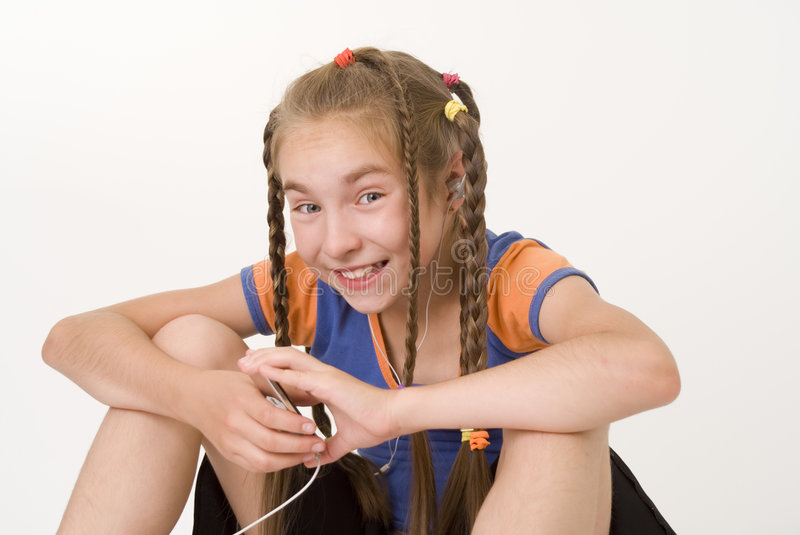 Download Girl With A Mediaplayer III Stock Image - Image: 2945321