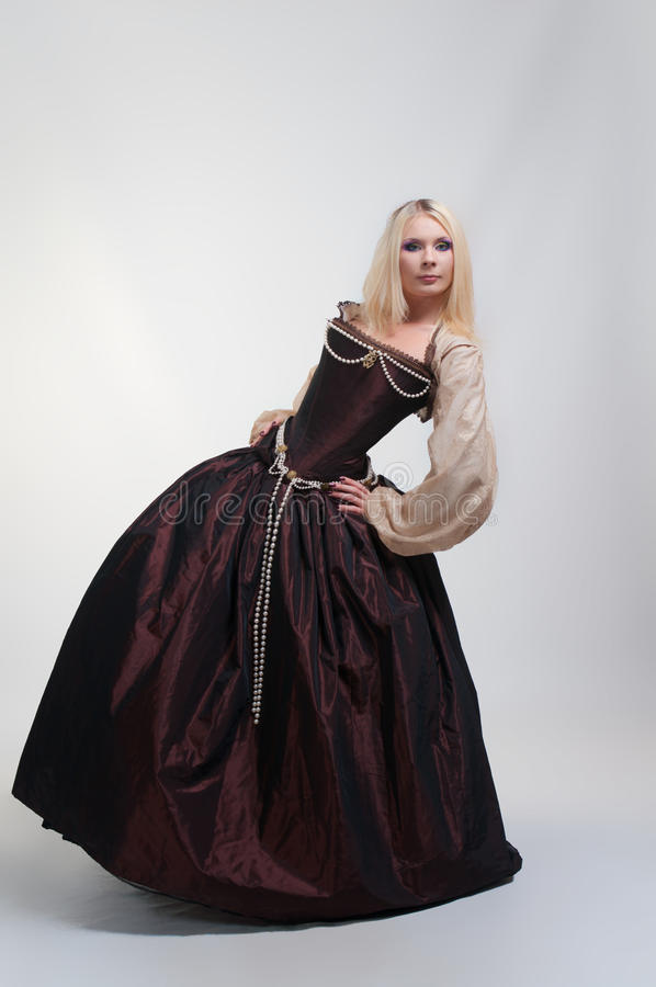 Girl in medieval beautiful dress. Over white background royalty free stock image