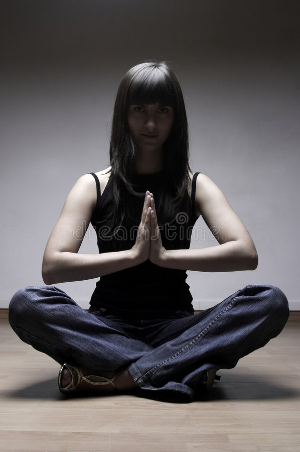The girl meditates stock images