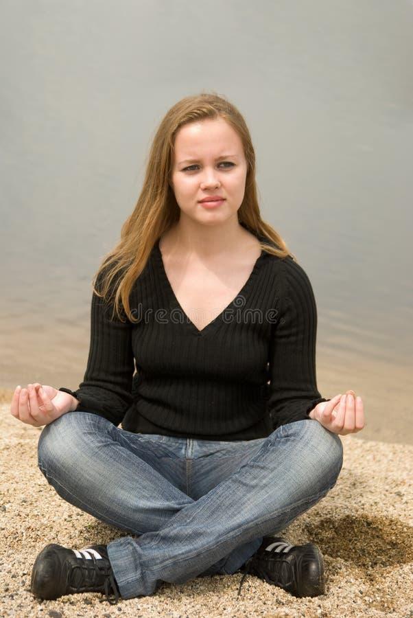 Girl Meditating Stock Images