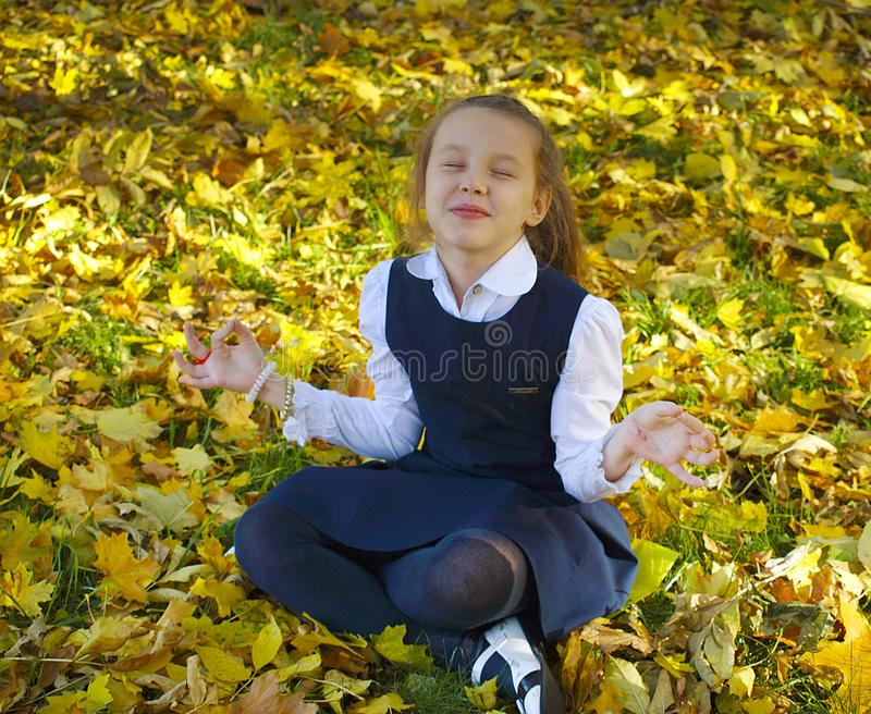 The girl is meditating stock photos