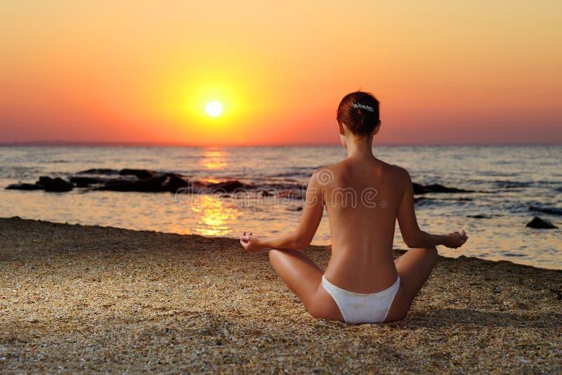 Girl Meditating In Sunrise Stock Image