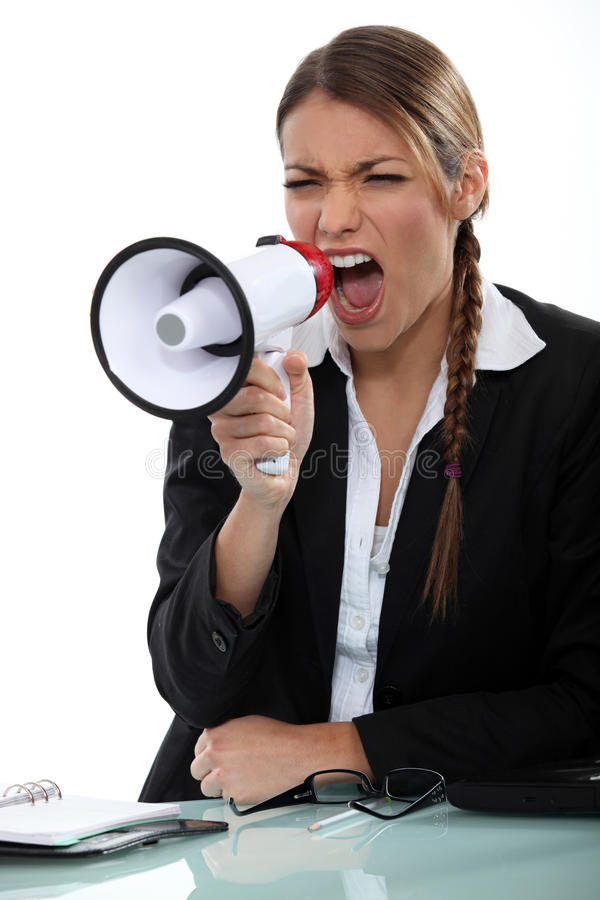 Girl with megaphone. Girl shouting through a megaphone stock images