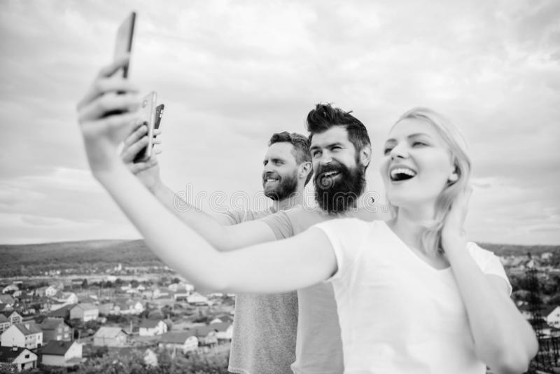 Girl and man with mobile smartphones communication online. Selfie time. Life online. People taking selfie or streaming royalty free stock photos