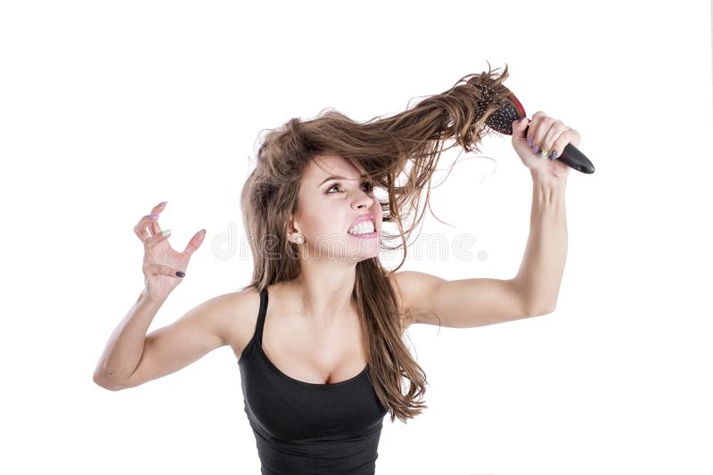Girl with messed up hair isolated on white background. Frustrated woman. Girl looking in despair. hair strength concept. royalty free stock image