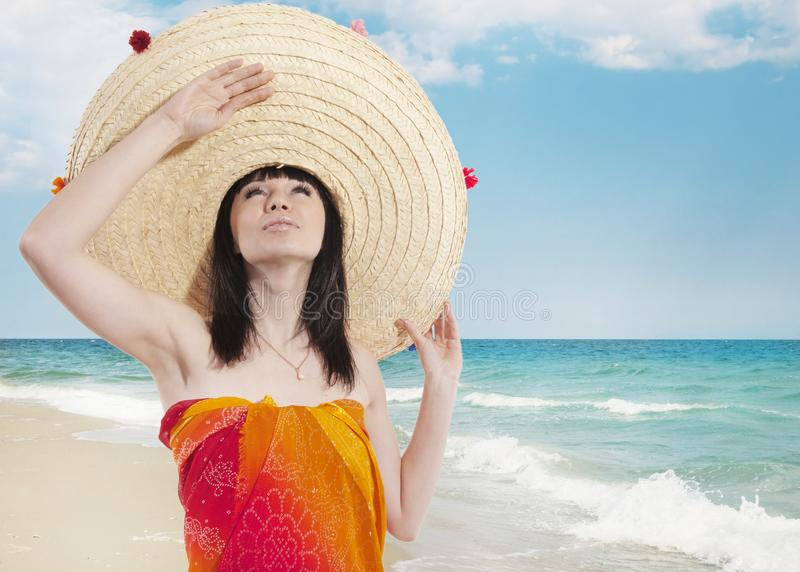 A girl in a Mexican hat. On the background of the sea stock images