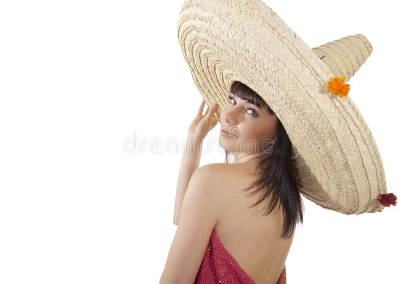 A girl in a Mexican hat. On white background stock photography