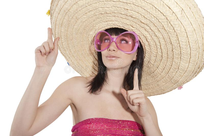 A girl in a Mexican hat. On white background royalty free stock image