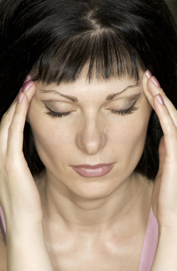 Girl with migraine. Young, beautiful girl suffers headaches, migraine royalty free stock photo