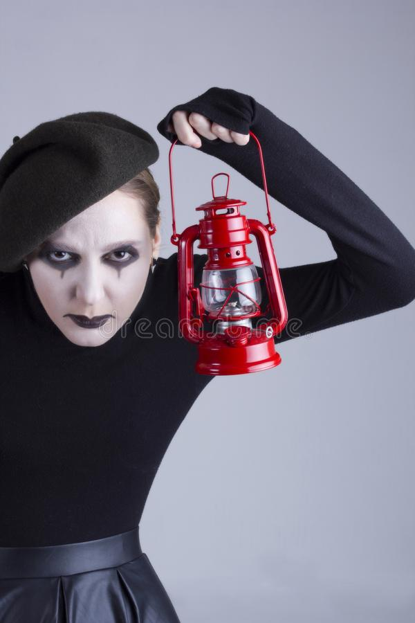 Girl mime with gas lamp stock image