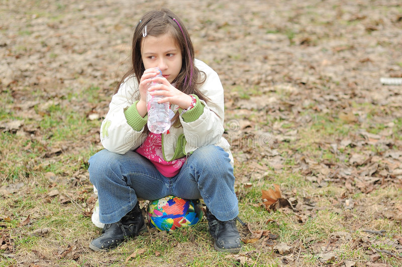 Girl with mineral water royalty free stock images