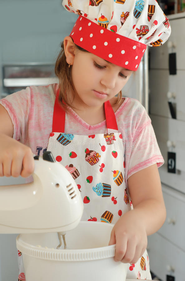 Girl mixing ingredients for a cake stock images