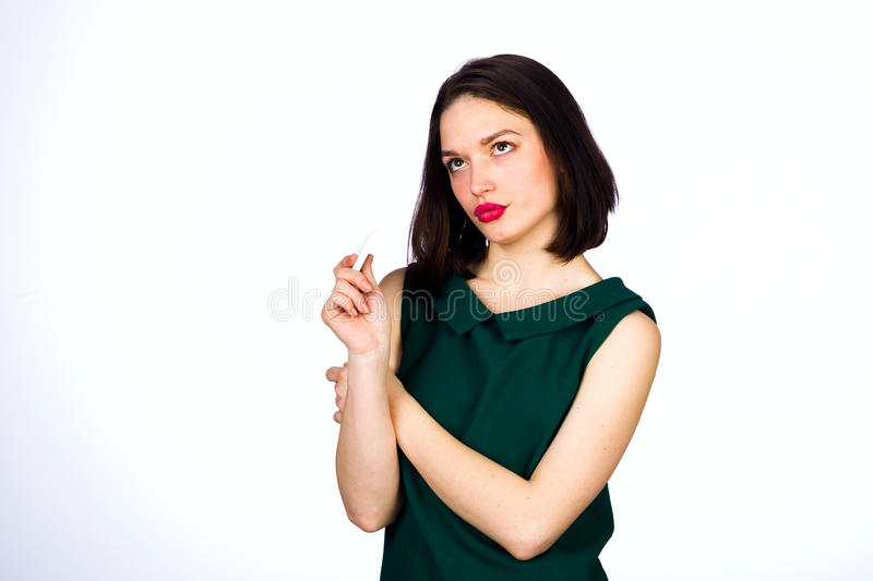 Girl with a mobile cell phone. Young girl with mobile cell phone on a white background, studio lighting stock images