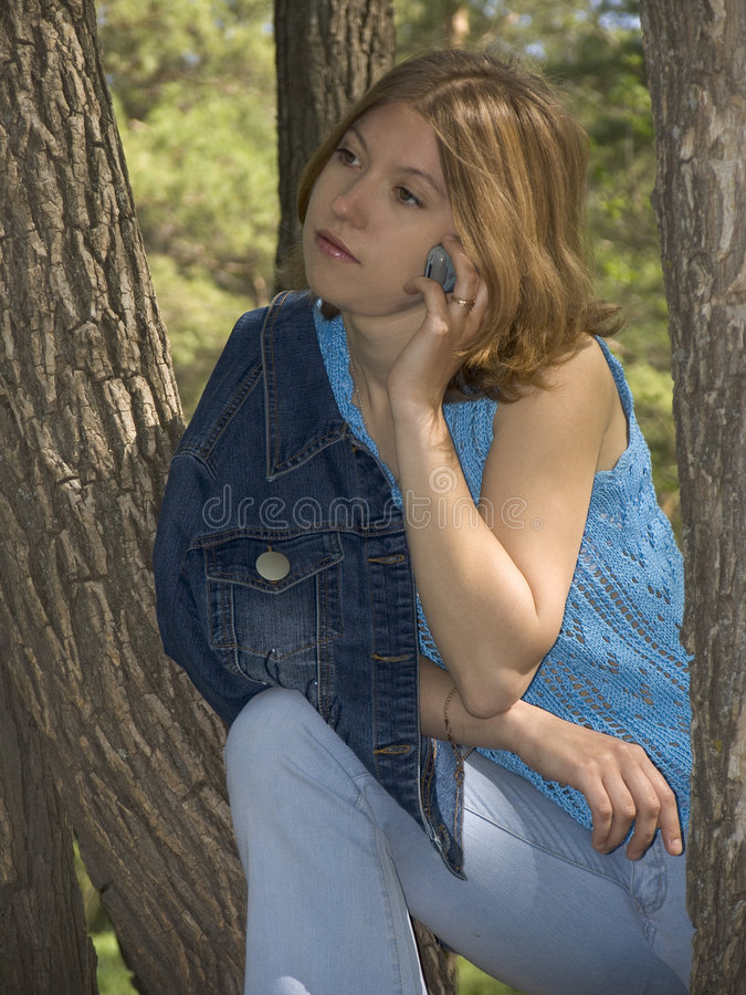 Download Girl with mobile phone stock photo. Image of tree, lifestyle - 131394