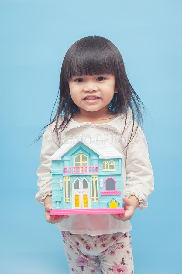 Girl, with model house. Asian little girl, with model house stock images