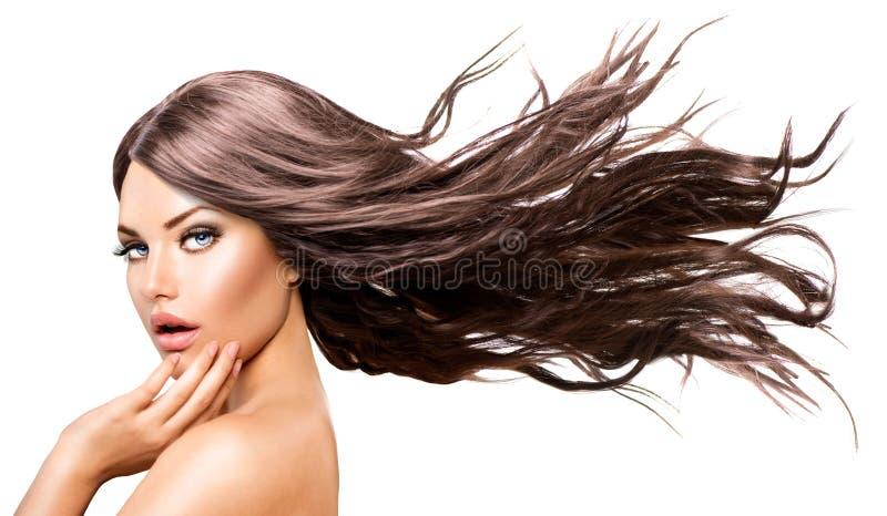 Girl modelo com cabelo de sopro longo fotografia de stock royalty free