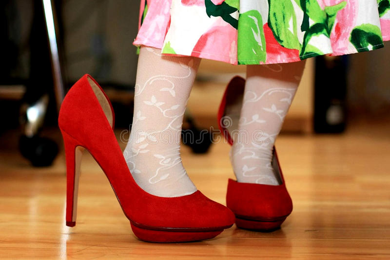 Girl in mom's shoes royalty free stock photography