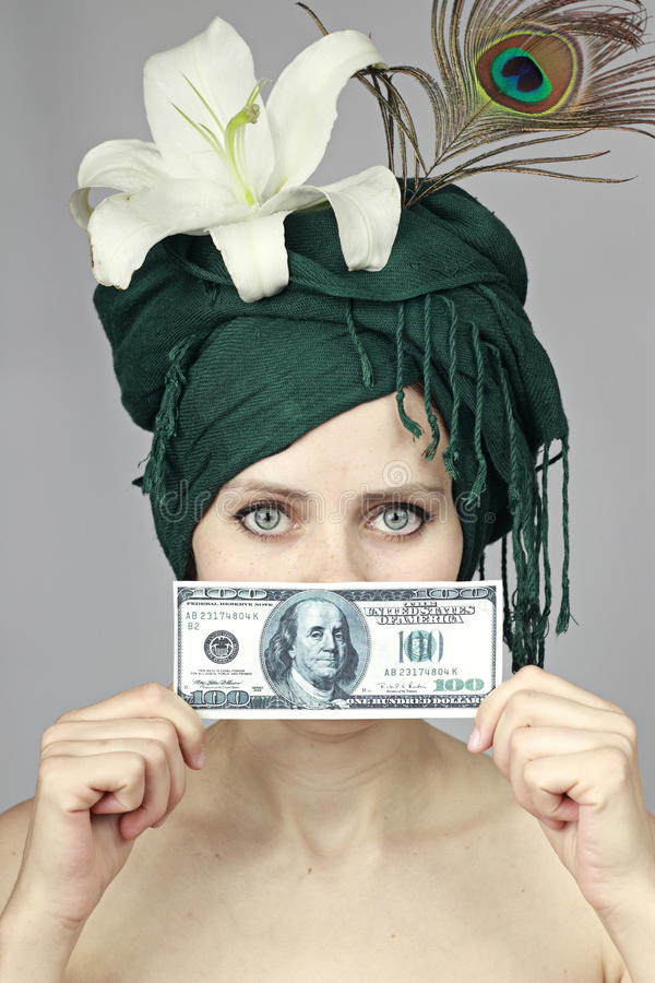 Girl with money near the person royalty free stock photography