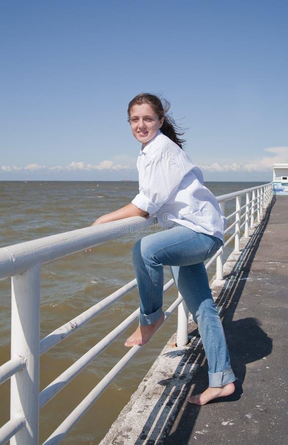 Girl on mooring stock photo