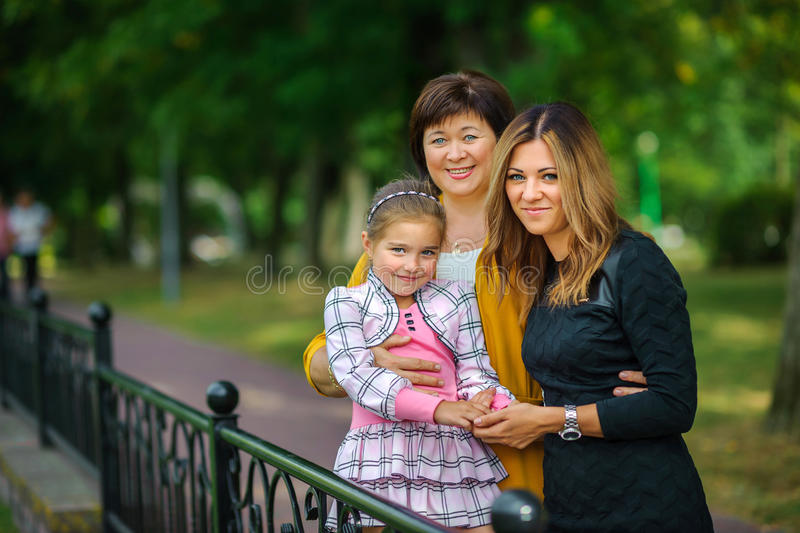 Girl with mother and grandmother stock images