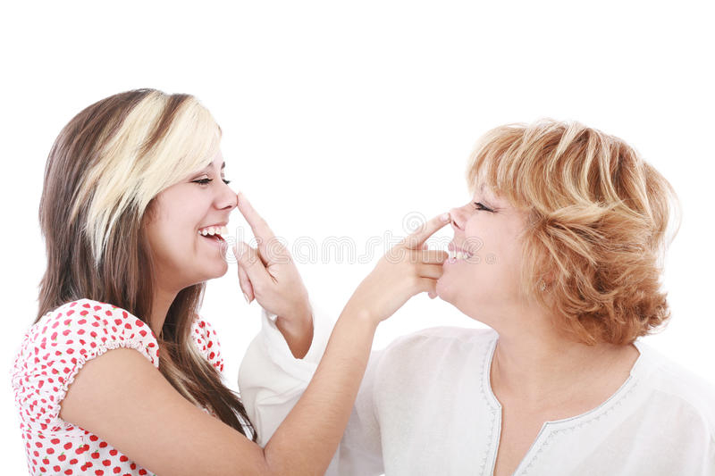Girl and mother profiles, playful woman with nose royalty free stock photos