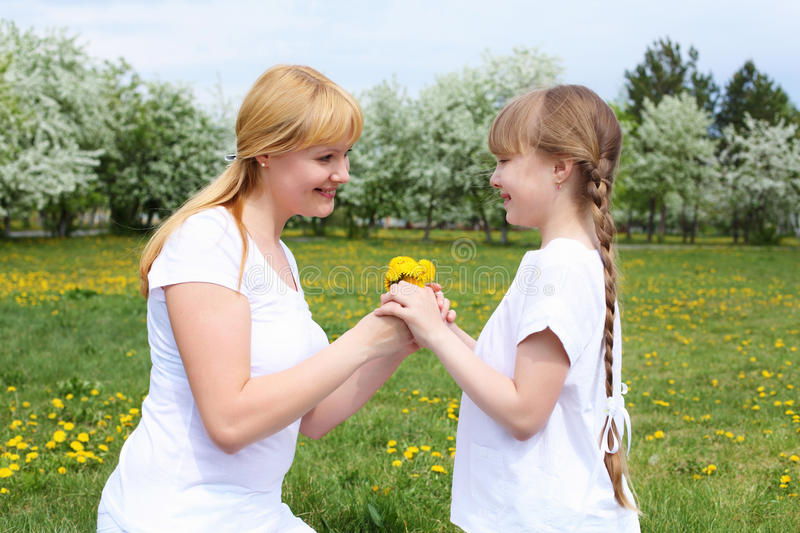 Download Girl With Mother In Spring Park Stock Image - Image: 19693811