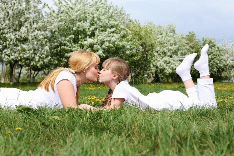 Download Girl With Mother In Spring Park Stock Photo - Image of attractive, little: 19693824