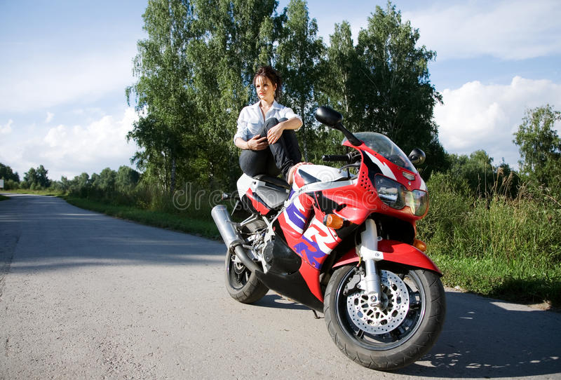 Download Girl with motorbike stock image. Image of long, brunette - 10510651