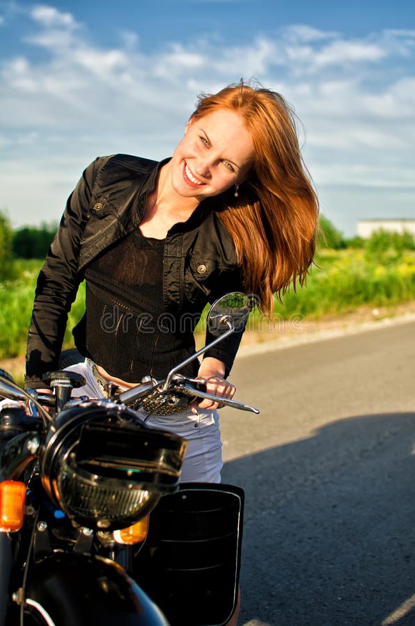 Download Girl On A Motorbike On A Road Stock Photo - Image: 25407272