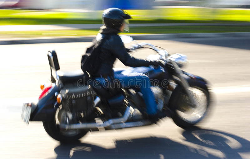 Girl and motorcicle stock photography