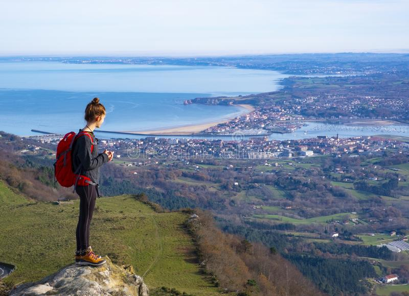 The girl at mountain top. Successful woman backpacker hiking royalty free stock photography