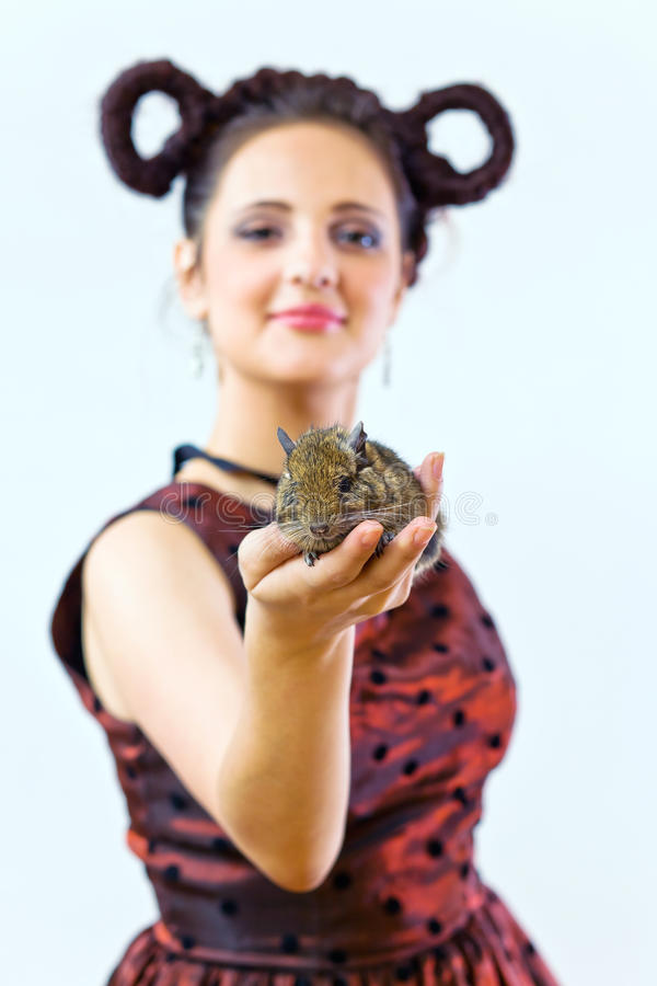 Download The girl with a mouse stock photo. Image of coiffure - 24787522