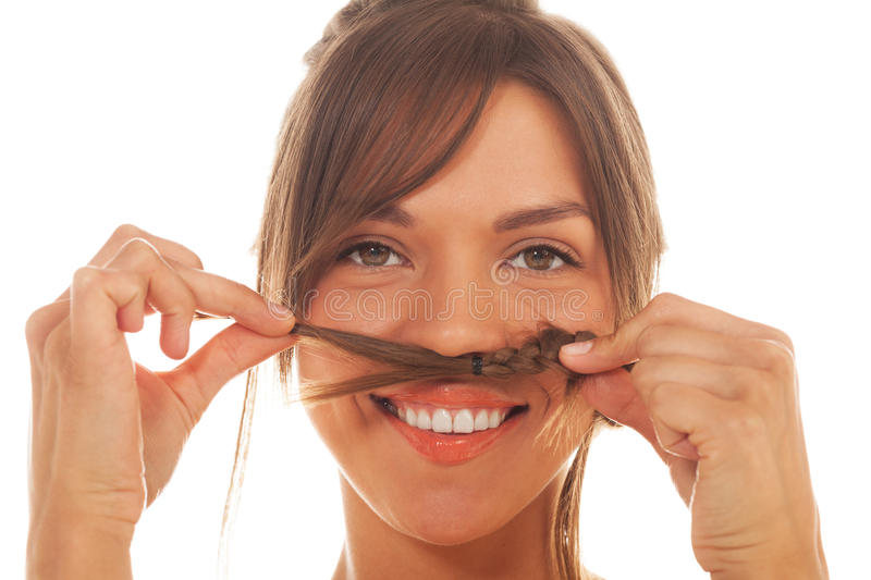Girl with moustache made of pigtail. Portrait of a girl with moustache made of pigtail on isolated white stock image